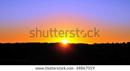 Beautiful Sunrise over a Silhouetted Horizon