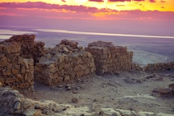 Beautiful sunrise over Masada fortress. Ruins of King Herod's palace in Judaean Desert.  Israel.