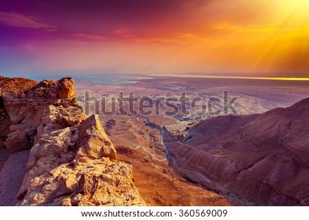 Beautiful sunrise over Masada fortress. Ruins of King Herod's palace in Judaean Desert. Wild nature Israel.
