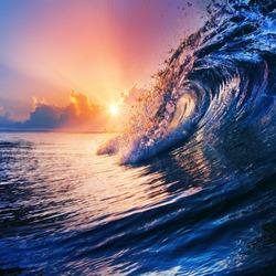 beautiful sunrise over ocean seascape with nice clouds on horizon