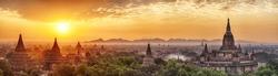Beautiful sunrise over old pagodas of an ancient city of Bagan, Myanmar. Panoramic photo