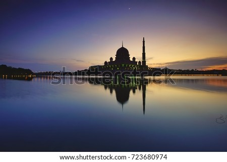 Beautiful sunrise over the majestic mosque, Putra Mosque (Masjid Putrajaya). Soft focus due to slow shutter shot. #723680974