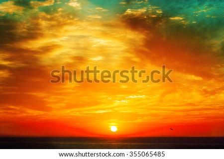 beautiful sunrise over the quiet calm sea