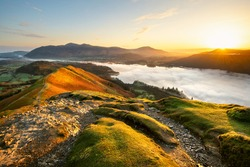 Beautiful Sunrise Overlooking Derwentwater From Catbells On A Sunny Calm Morning With Cloud Inversion Mist Over Lake. Lake District National Park, UK.