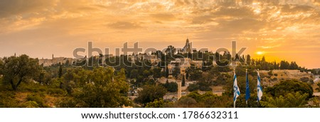 Beautiful sunrise panorama of Mount Zion: Dormition Abbey, Jerusalem university college and greek ceminary; with walls of Jerusalem's Old City, leading up to the Tower of David and Jaffa Gate Stock photo ©