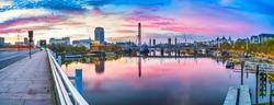 Beautiful sunrise panorama of river Thames overlooking Jubilee bridge and Big Ben clock in London. England
