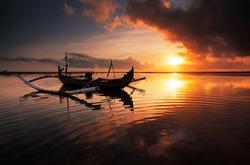 Beautiful Sunrise Scene in Bali, Indonesia. The rowboat or