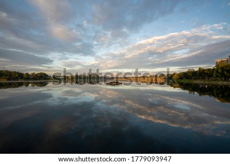 Photo of  Beautiful sunrise shot at Lower Seletar Reservoir Park, Yishun, Singapore. Tranquil water, reflection, forest, viewing deck and MRT railway track.