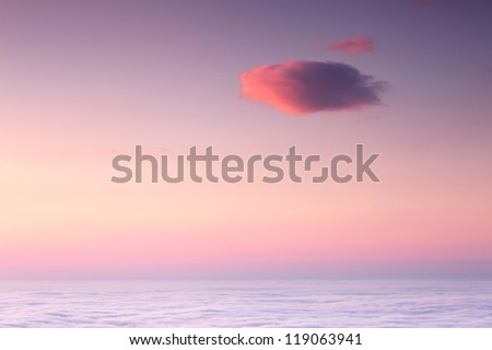 Beautiful sunrise sky with lonely cloud