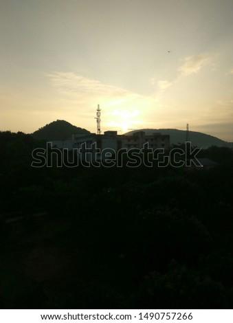 Beautiful sunrise. Skyline sunrise. Silhouette buildings and golden sun.