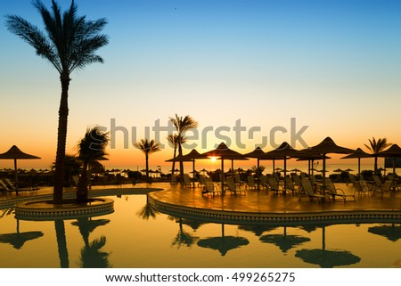 Beautiful sunrise with a view of the pool and the sea. Hurghada. Egypt #499265275