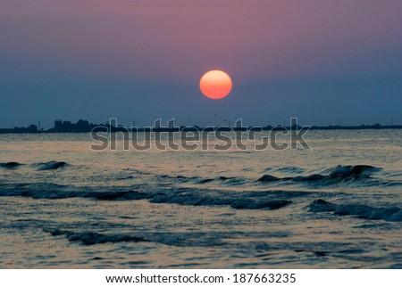 Beautiful sunrise with in Sulina harbor, Danube Delta, Romania. Image has a pleasant grain texture visible on its maximum size