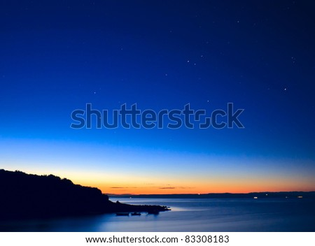 Beautiful sunrise with visible stars