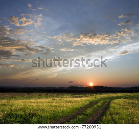 Beautiful sunset above rural lane. Square composition