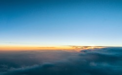 Beautiful sunset above the clouds