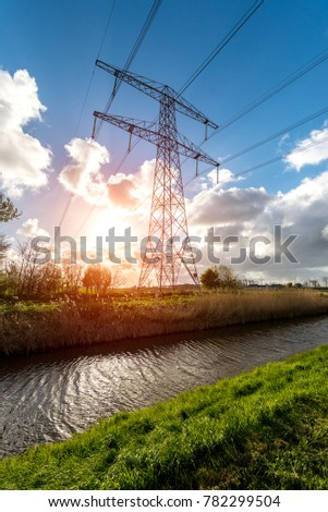 Beautiful sunset above the modern high powerlines #782299504