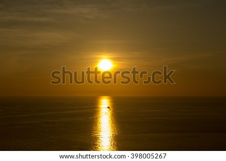 Beautiful sunset above the sea #398005267