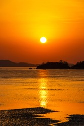 Beautiful sunset above the sea. The sunset of the mud flats. Sunset reflected in ocean mud flats. Ganghwa-island, Incheon, Republic of Korea.