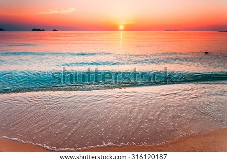 Beautiful sunset above the sea, view from the beach #316120187