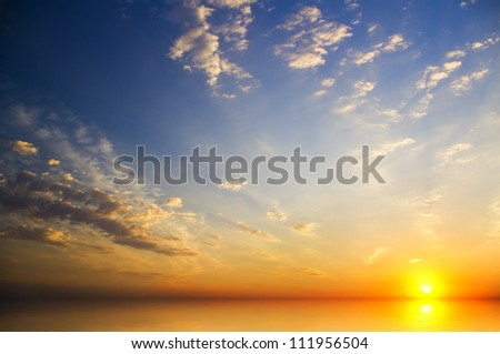 Beautiful sunset above the sea. white clouds on the horizon and over the waves of a tropical sea at sunset.tranquil summer seascape.  #111956504