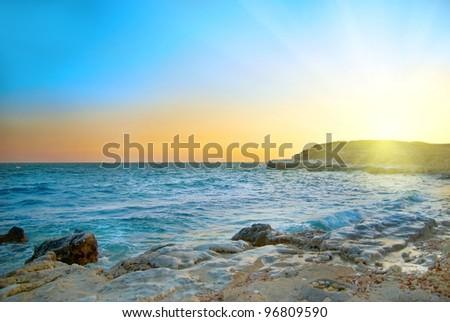 Beautiful sunset above the stormy winter sea