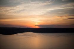 Beautiful sunset above wide lake