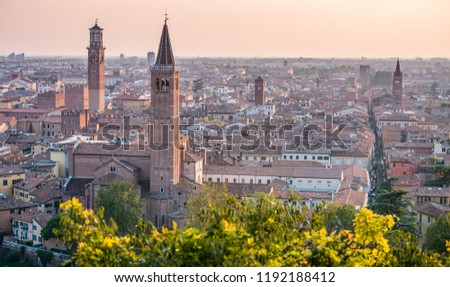 Beautiful sunset aerial view of old town of Verona, Veneto, Italy, Torre Lamberti and Santa Anastasia bell tower from Piazzale Castel S. Pietro