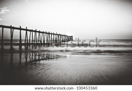 Beautiful Sunset and old wood bridge to the sea, Black and white