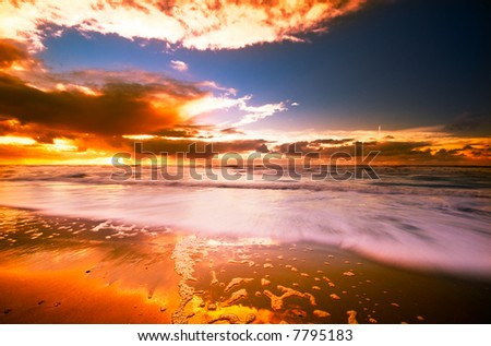 beautiful sunset and waves on the beach