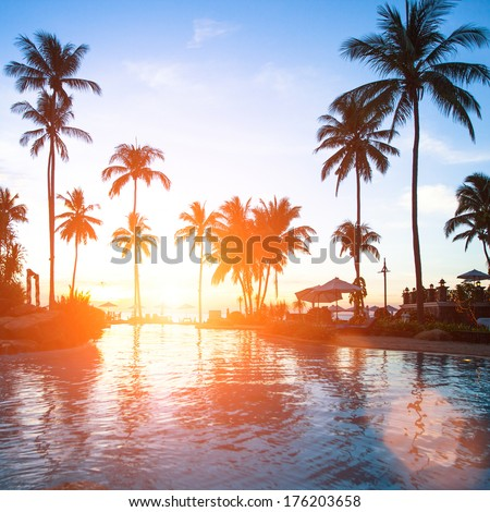 Beautiful sunset at a beach resort in tropics.