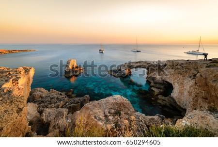 Beautiful sunset at natural stone bridge near Ayia Napa on Cyprus, Europe. Love bridge. Cavo greco Stock fotó ©