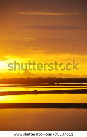 beautiful sunset at saline in thailand