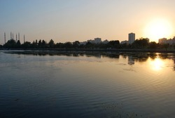 Beautiful sunset at Seyhan River with silhouette of cityscape