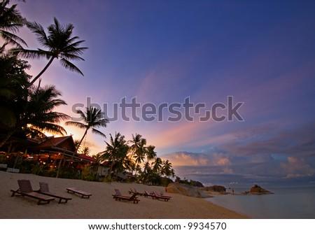 Beautiful sunset at the beach - stock photo