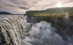 Beautiful sunset at the Dettifoss waterfall. Imposing bed of the Dettifoss waterfall