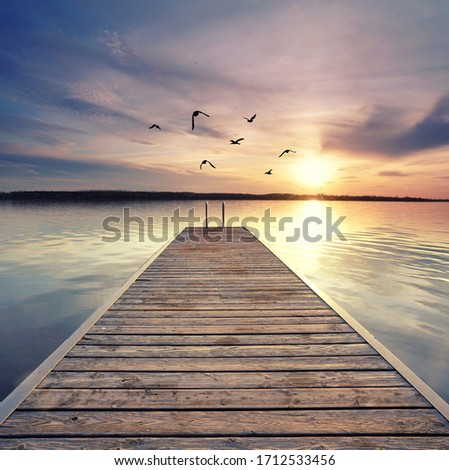 beautiful sunset at the wooden jetty at the beach Foto d'archivio ©