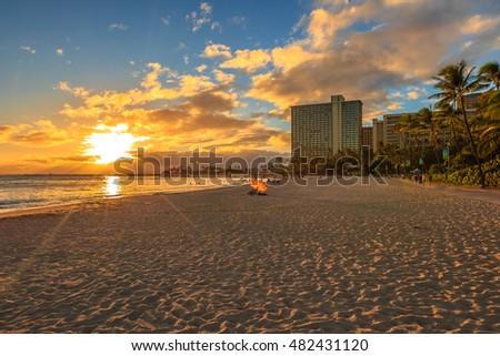 Stock Photo Beautiful sunset at Waikiki beach in Oahu. Waikiki beach, South Shore, is neighborhood of Honolulu and the most popular beach of Hawai.