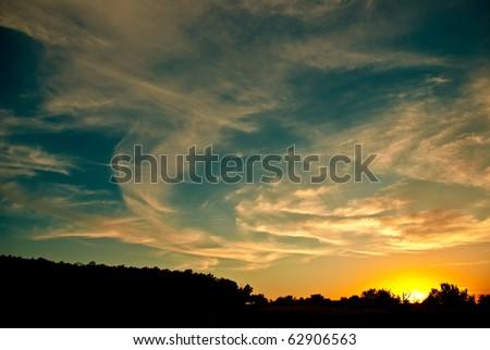 beautiful sunset behind a cloud