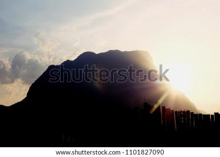 Beautiful sunset behind the mountain, Chiangmai Thailand #1101827090