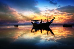 Beautiful Sunset Boats in seaside with red and dark sky. Dammam -Saudi Arabia