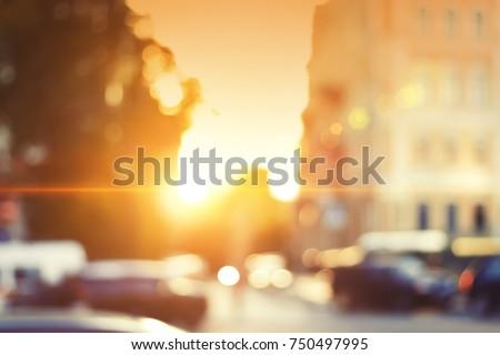 Beautiful sunset city bokeh. Blurred background photo.