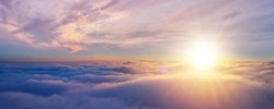 Beautiful sunset cloudy sky from aerial view. Airplane view above clouds