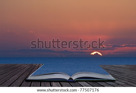 Beautiful sunset contained in book spills out and blends into landscape background