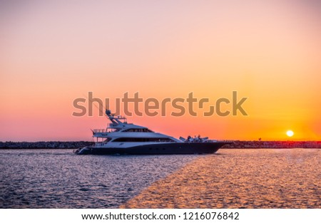 Beautiful Sunset from Seal Beach Jetty,  is the northernmost beach in Orange County…before you move north into Long Beach and LA County - California Beaches a Luxury Yacht boat passing.
