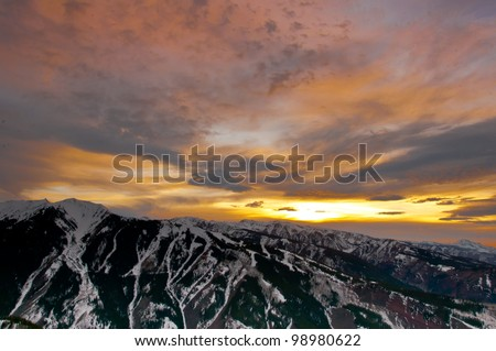Beautiful sunset in Colorado as the sun disappeared  behind the Aspen Highlands ski area