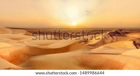 Beautiful Sunset in hot desert with dunes Sahara Dubai Africa or Gobi