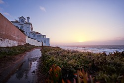 Beautiful sunset in portuguese village on the ocean shore.