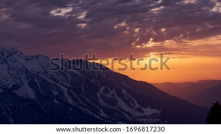 Beautiful sunset in the snowy mountains. Sochi. Krasnaya Polyana. Rosa Khutor