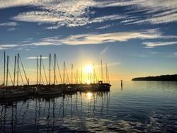 Beautiful sunset in White Rock Marina, Surrey, BC, Canada yachts mirror reflection