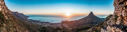 Beautiful sunset - Kloof corner, Table mountain as the sun goes down, views of Camps Bay, Clifton beach, Lion's Head and Twelve Apostles. Great adventure travel destination, Cape Town, South Africa